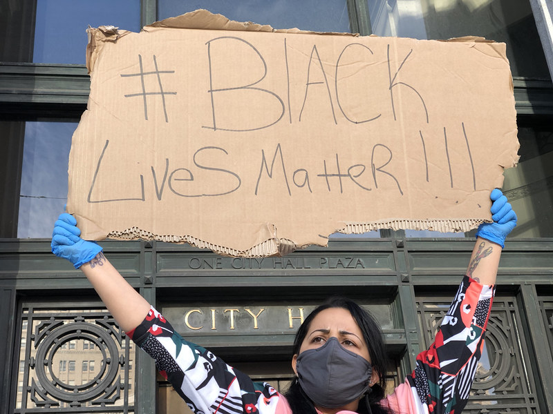person holding black lives matter sign