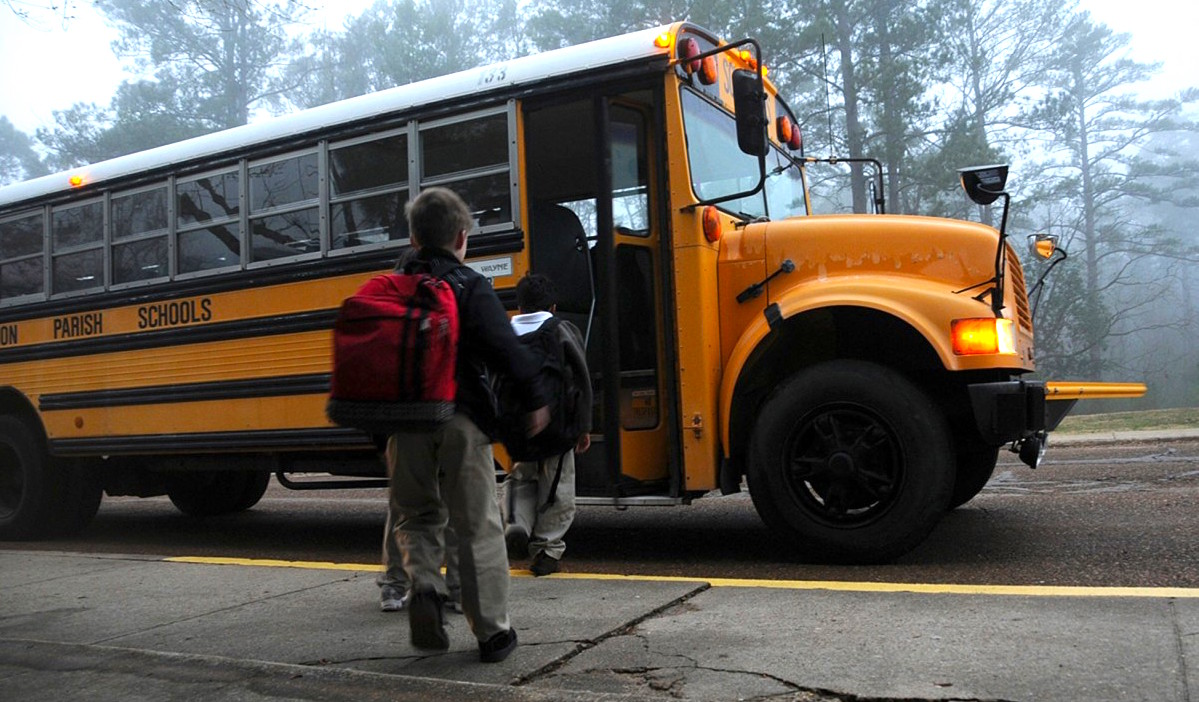 image of children getting on school bus
